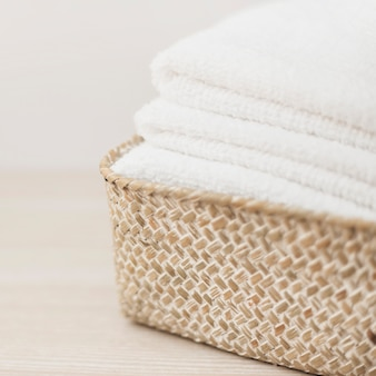 Stack of white towels in basket