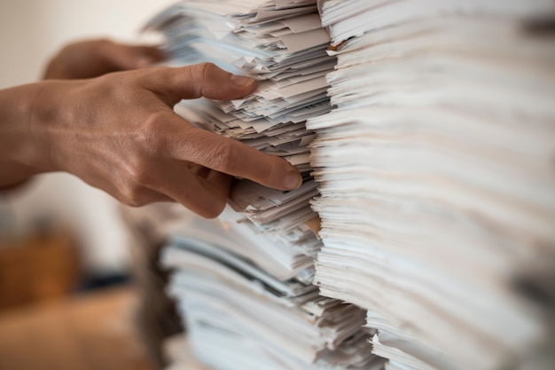 Stack of office paper business documents.