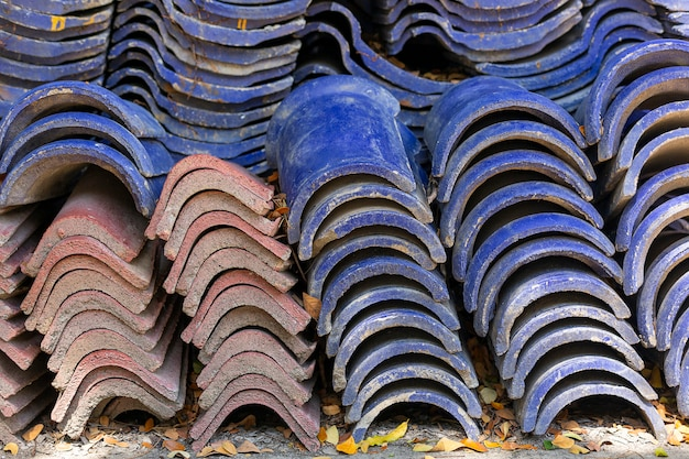 Stack of old blue roof tiles for construction