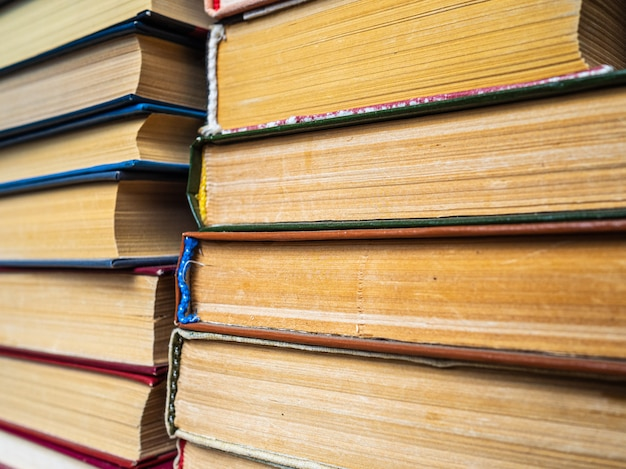 A stack of old books in the book market. stacked books on a shelf