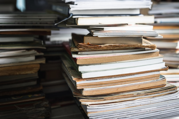 Stack of old books on wooden table,