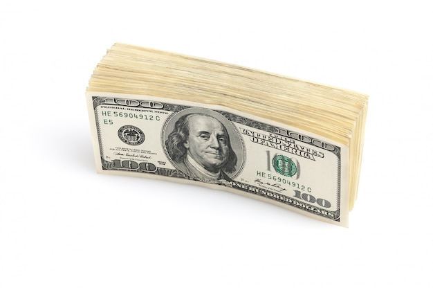 A stack of one hundred dollar american notes standing on a white background