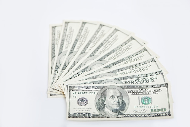 A stack of one thousand dollars in one hundred dollar banknotes isolated on a white background.