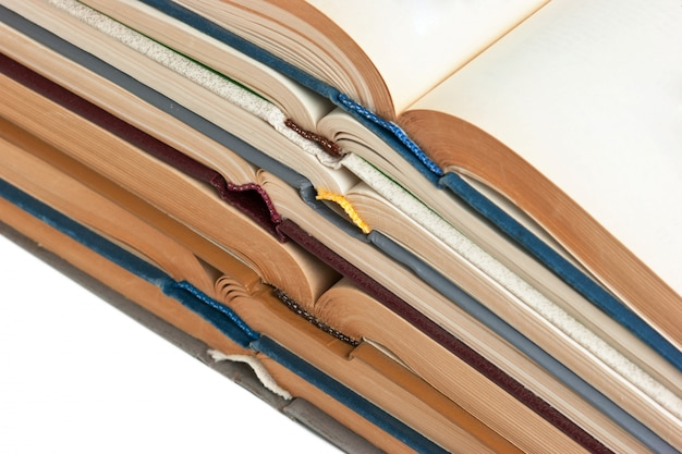 Stack of open books  isolated on a white surface