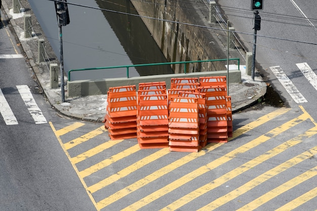 Stack of orange cones for traffic closure on city street