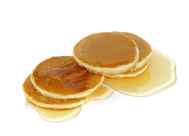 Stack of pancakes top with honey