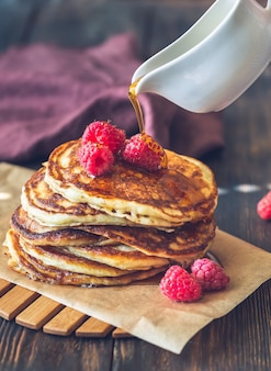 Stack of pancakes with raspberries