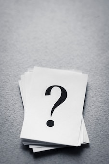 Stack of paper cards with a printed question mark