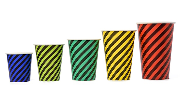 Stack of paper disposable striped cups isolated on white background, zero waste
