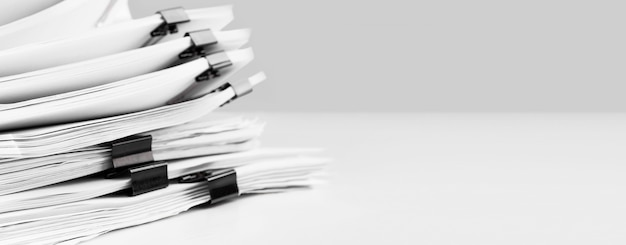 Stack of paper documents on business desk
