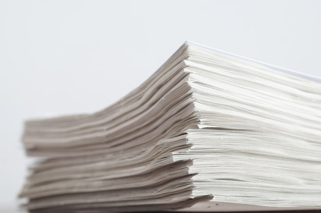 Stack of paper on table