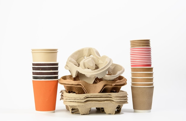 Stack of paper takeaway beverage holders  and disposable cups on a white background, zero waste