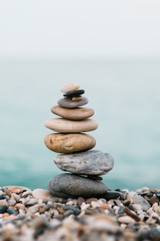 Stack of pebble stones on the beach. spa and spiritual concept