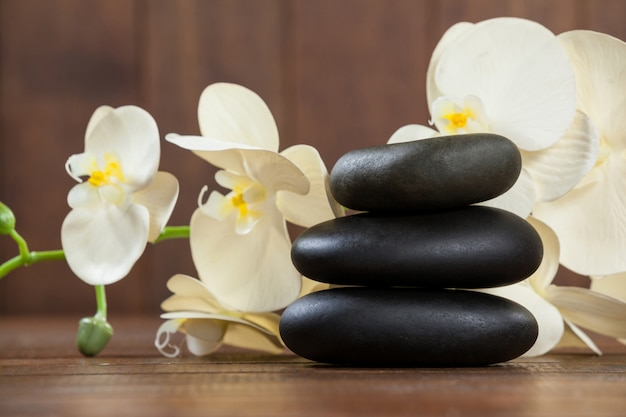 Stack of pebble stones with flowers