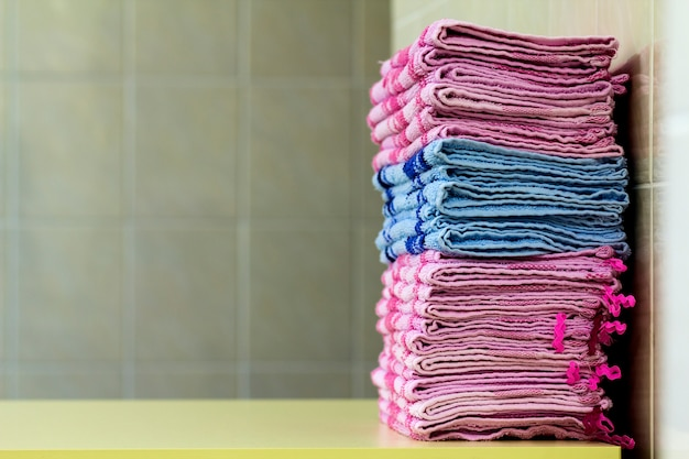 Stack of pink bath towels close-up