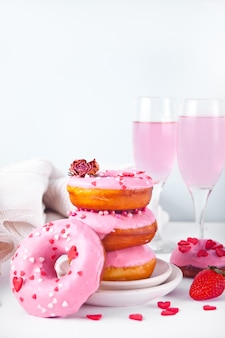 Stack of pink doughnuts on the plate. valentine's day concept.