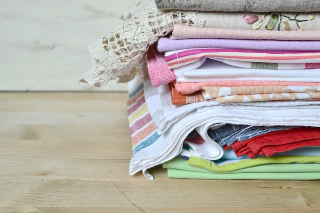 Stack of pressed home linen on wood