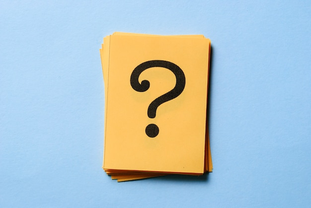 Stack of question marks on yellow cards