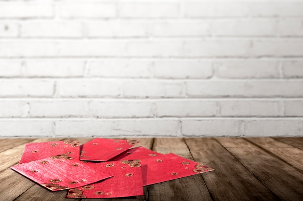 Stack of red envelopes on wooden table to celebrate chinese new year