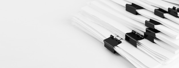 Stack of report paper documents for business desk. business offices concept, soft focus.