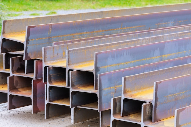 The stack of rolled metal is at the factory, overlooking the steel profile. heavy metallurgy.