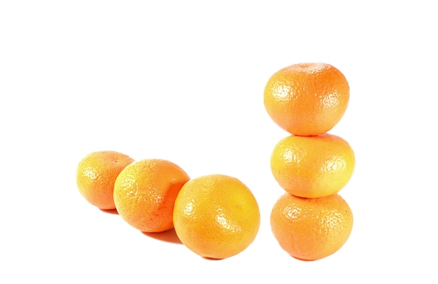 Stack and row of mandarin oranges isolated on white backdrop