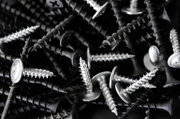 Stack of self-tapping screws. professional instrument, builder equipment, fasteners, fastening tools