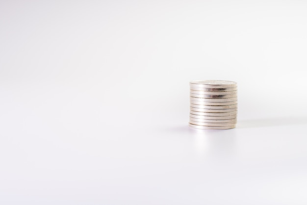 Stack of silver coins isolated on white background, industry