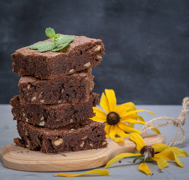 Stack of square pieces of chocolate brownie cake