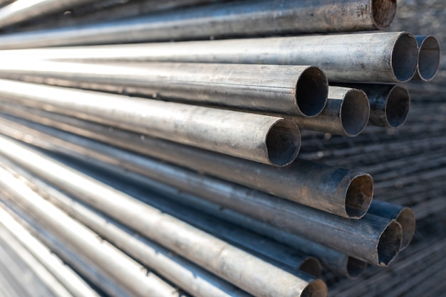 Stack of steel pipes for the construction of scaffolding.