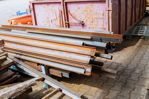Stack of steel and rusty rail profiles. rail cross-sections. waste production.