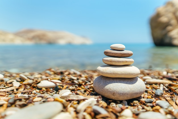 Stack of stones on the beach near sea