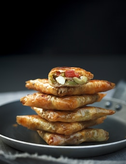 Stack of stuffed biscuits in a pot