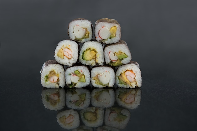 Stack of sushi on black table