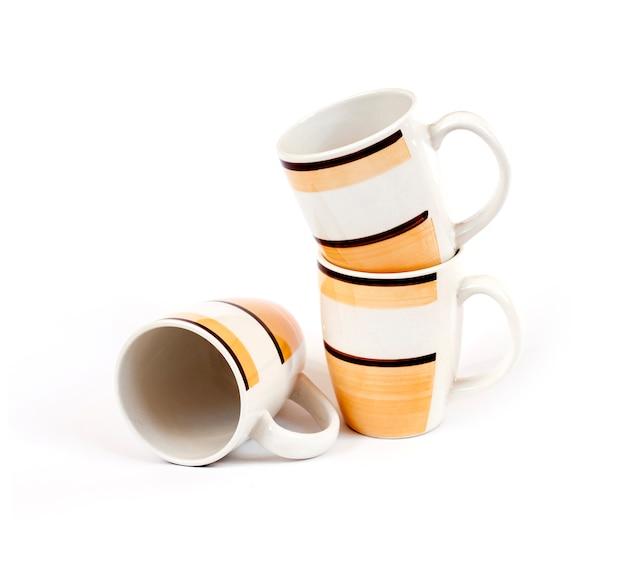 Stack of three mugs isolated