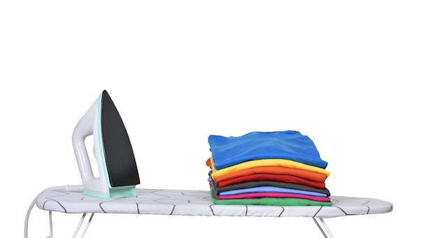 Stack of tidy clothes and a iron on ironing board