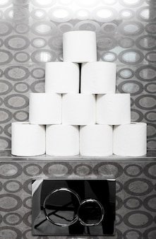 Stack of toilet paper rolls on shelf