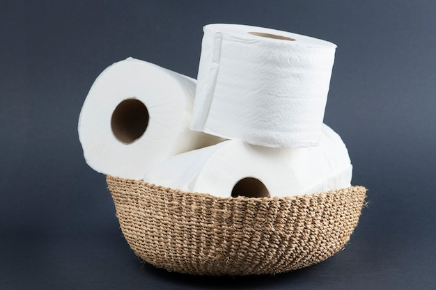 Stack of toilet paper rolls on wicker basket
