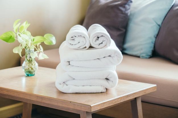 Stack of towel on table