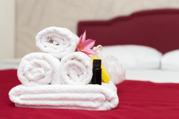 Stack of towels with flower decor in a hotel room