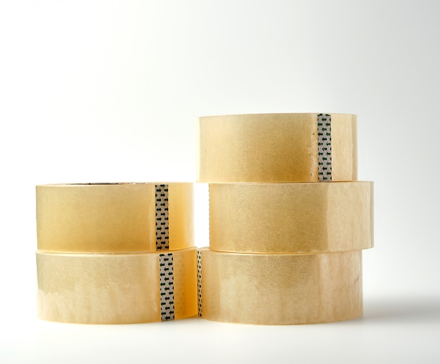 Stack of transparent adhesive tape on a white , close up