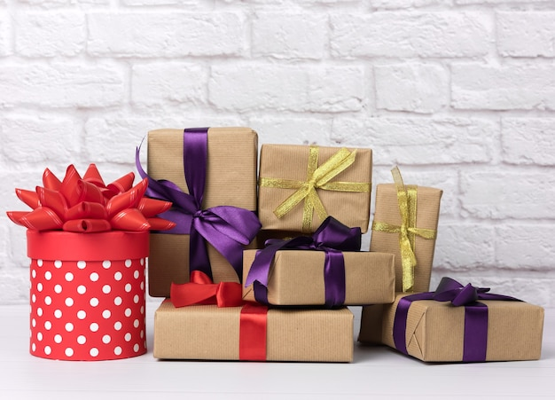 Stack of various gift boxes on white brick