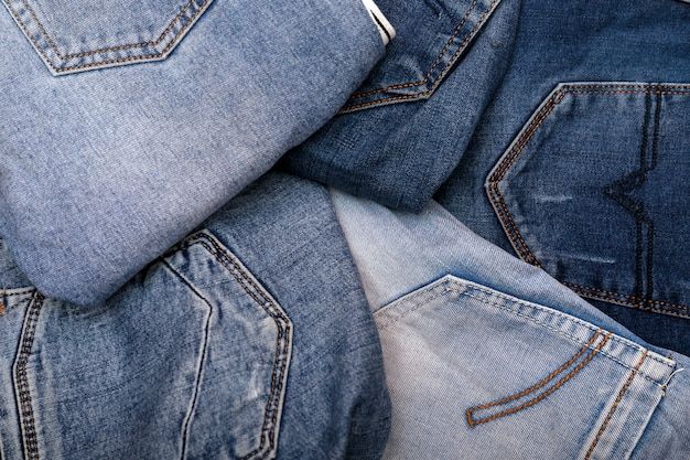 Stack of various shades of blue jeans