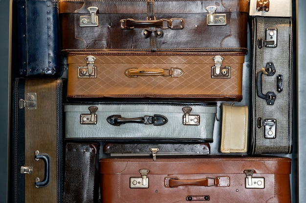Stack of vintage leather suitcases background