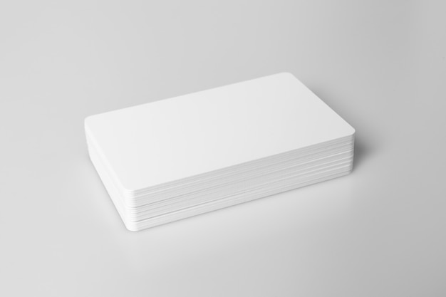 Stack of  white blank credit card on white