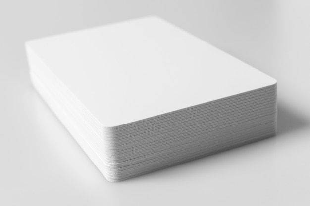 Stack of white blank credit cards mockup on white.