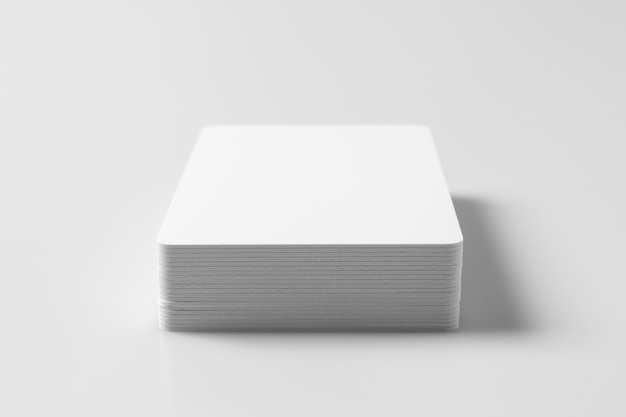 Stack of  white blank credit cards on white