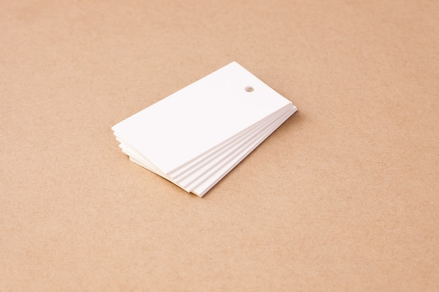 Stack of white blank rectangular paper tag labels for clothing price tags