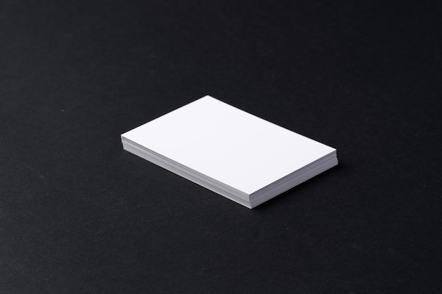 Stack of white business cards on black background