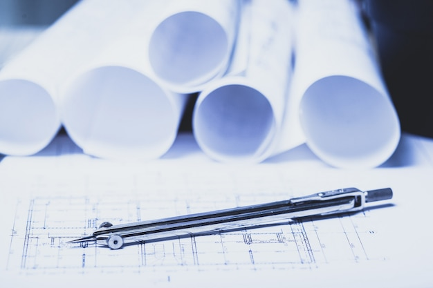Stack of white construction blueprints